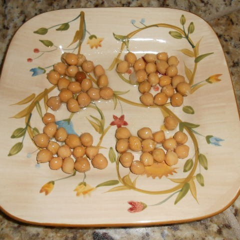 Start with 4 tablespoons of garbanzos